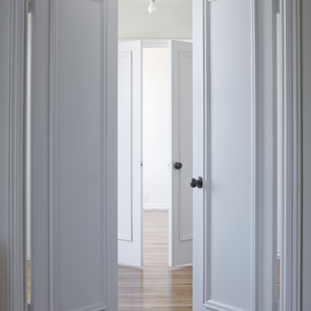 """""""White door and hardwood floor"""" stock image"""
