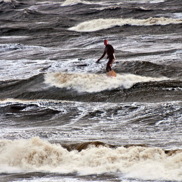 """""""Surfing during a storm"""" stock image"""