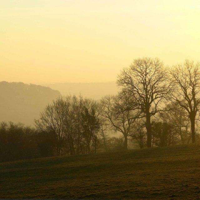 """Early evening misty sunset"" stock image"