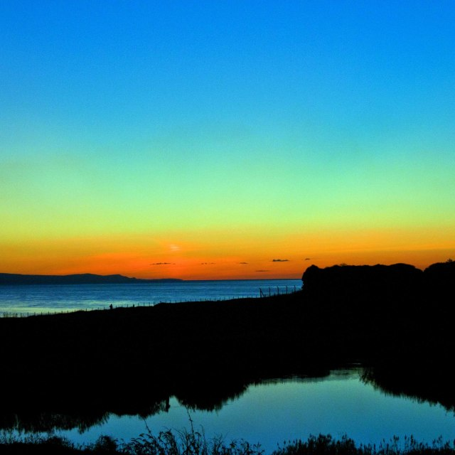 """""""Sun setting over the Bristol Channel."""" stock image"""