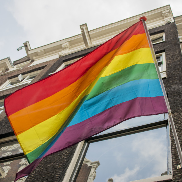 """Rainbow flag flying in Amsterdam"" stock image"