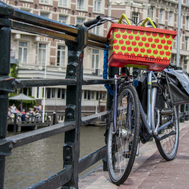 """Bike chained to bridge in Amsterdam"" stock image"