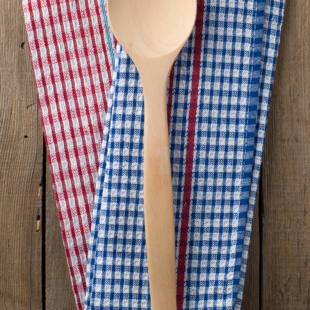 """Wooden spoon and dish towels"" stock image"
