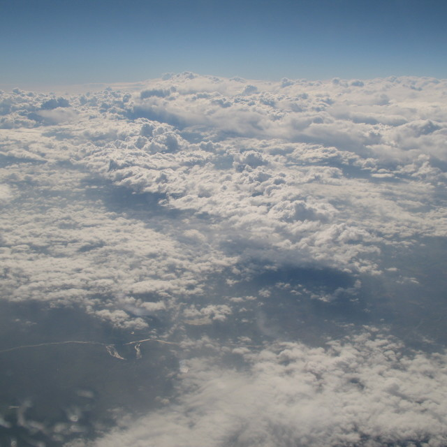 """Cloudy days look good from up here"" stock image"