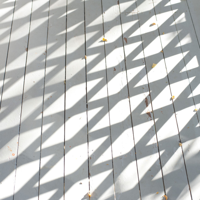 """Wooden deck with diamond shadows"" stock image"