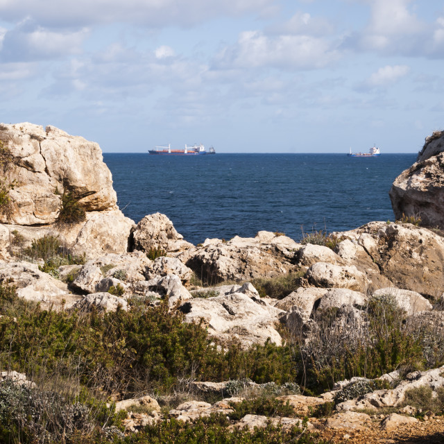 """Tankers of the rocky coast of Malta"" stock image"