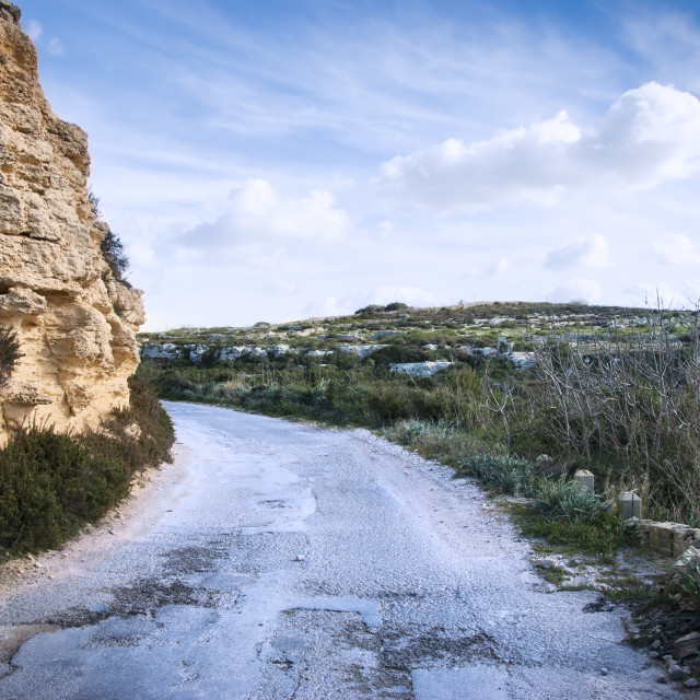 """""""Old tarmac road in Maltese garigue countryside"""" stock image"""
