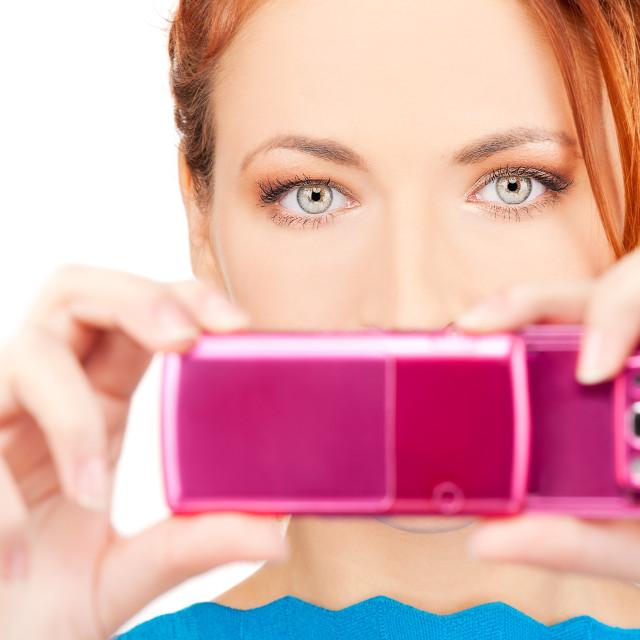 """redhead woman using phone camera"" stock image"