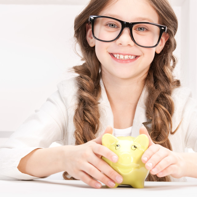"""""""little girl with piggy bank"""" stock image"""