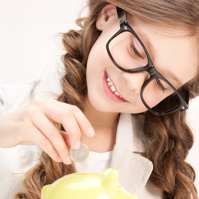 """""""little girl with piggy bank and coin"""" stock image"""