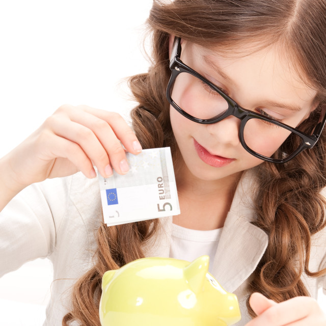 """""""little girl with piggy bank and money"""" stock image"""