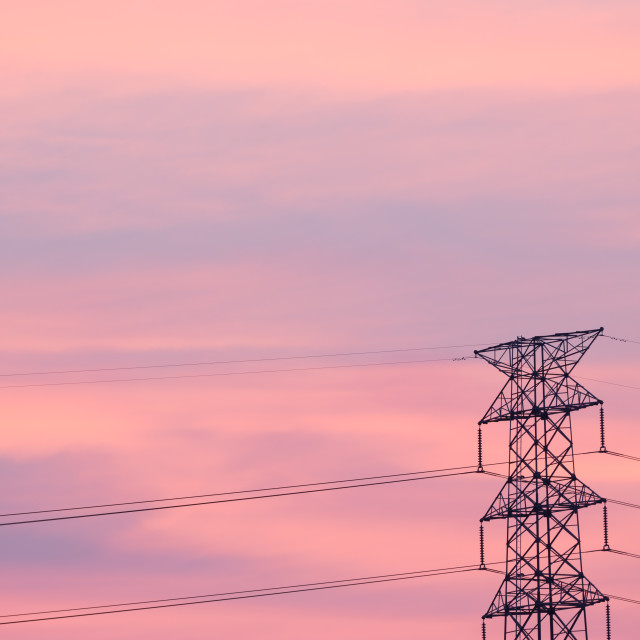 """Silhouette electric pylon shot against sunset background"" stock image"