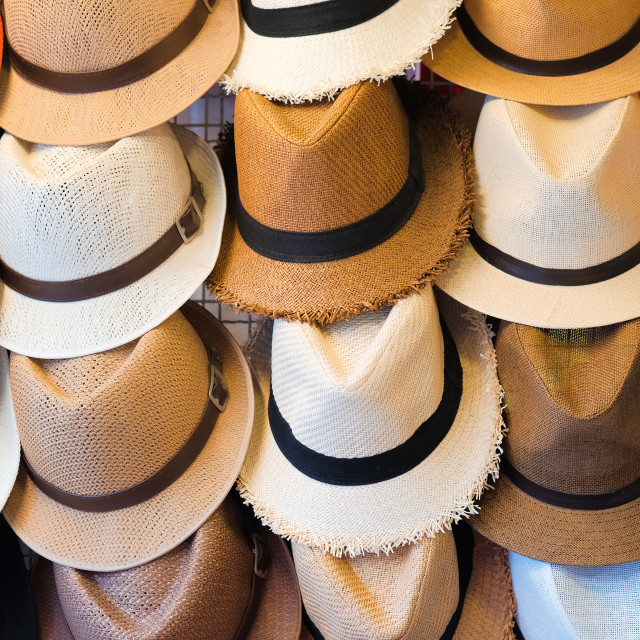"""Starw hats for sale, hanging on a wall"" stock image"