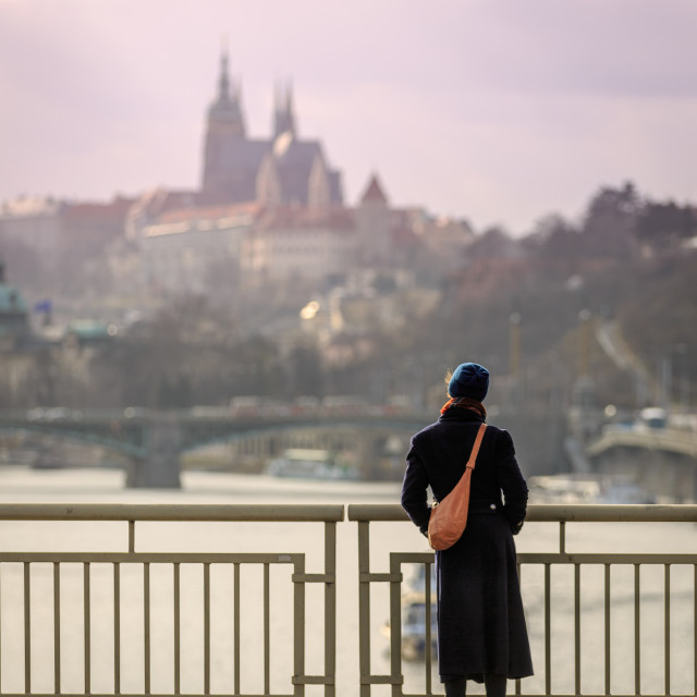 """Girl looking at Prague Castle"" stock image"