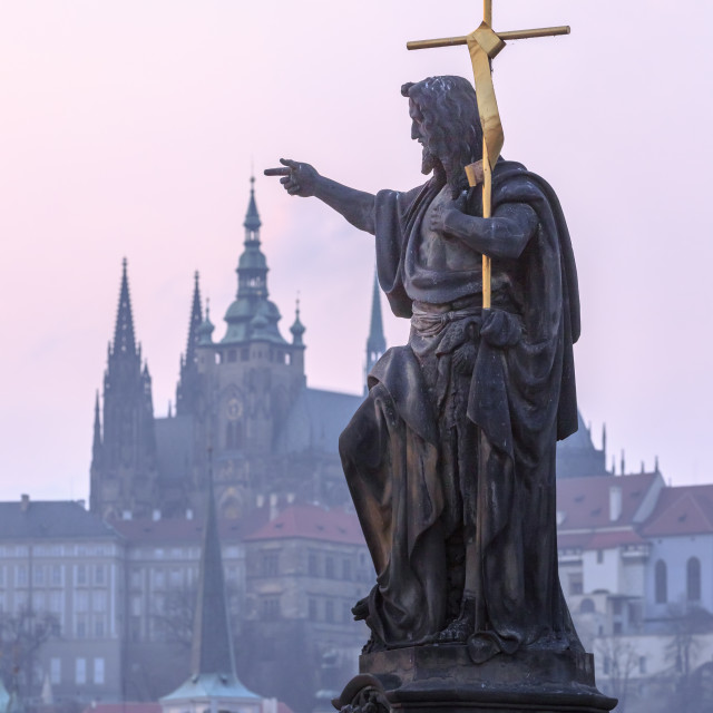 """""""Statue pointing at Prague Castle in Prague"""" stock image"""