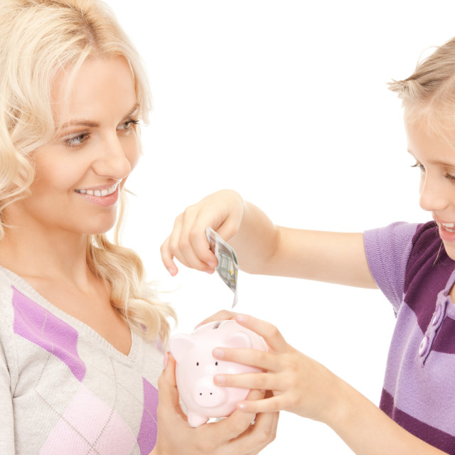 """""""mother and little girl with piggy bank"""" stock image"""