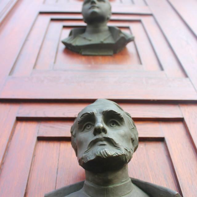 """""""Door Statues"""" stock image"""
