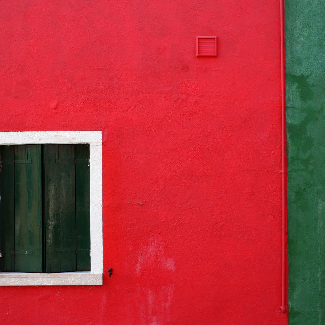 """Red and green wall with wooden window"" stock image"