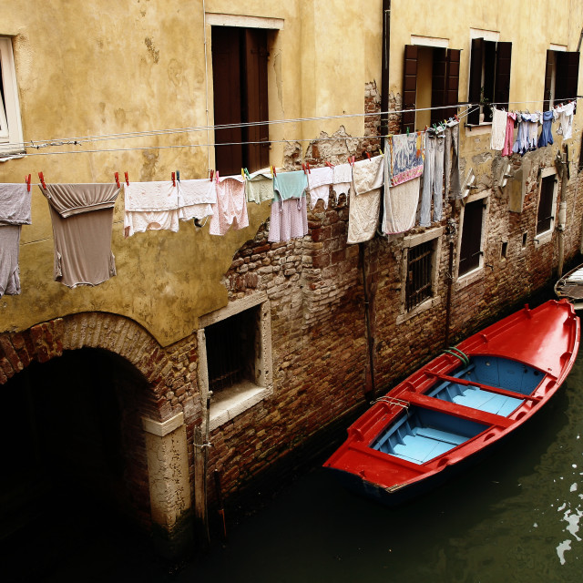 """Boats moored in a canal in Venice"" stock image"