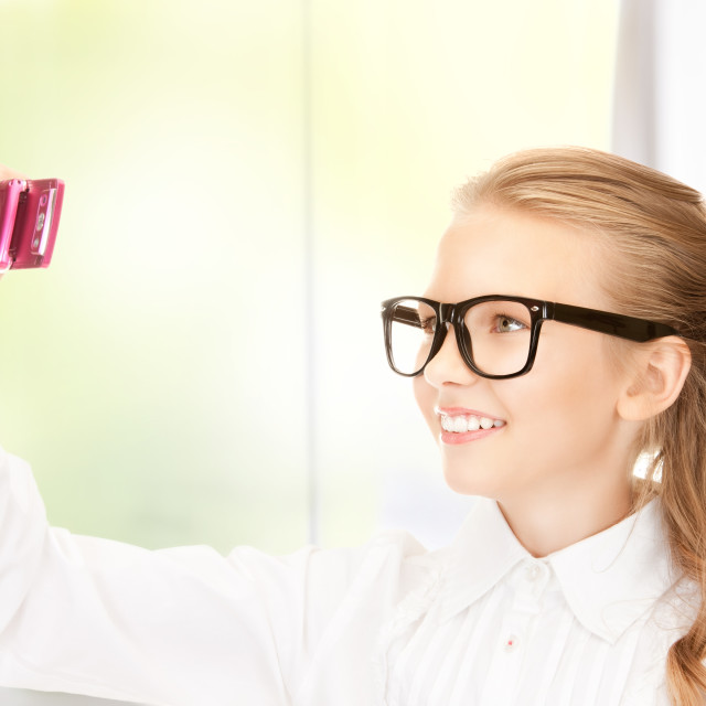 """""""happy girl taking picture with cell phone"""" stock image"""