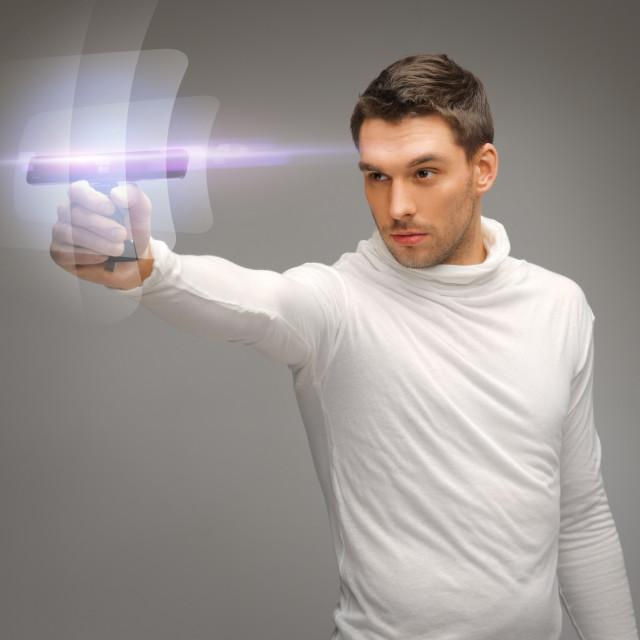 """futuristic man with gadget"" stock image"