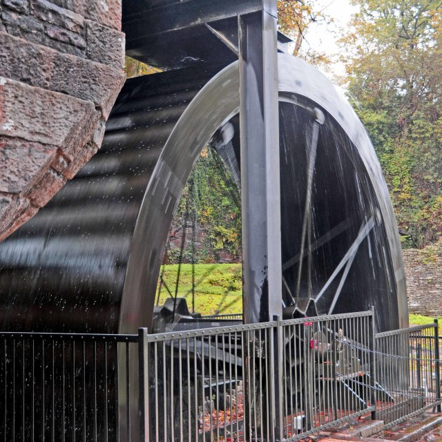 """Water cascading onto a waterwheel at Aberdulais tin works museum"" stock image"
