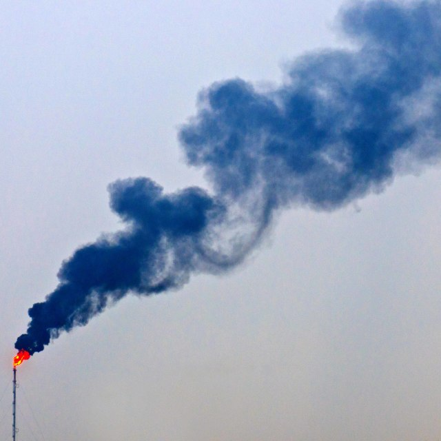 """""""Smoke from an oil refinery flare stack"""" stock image"""