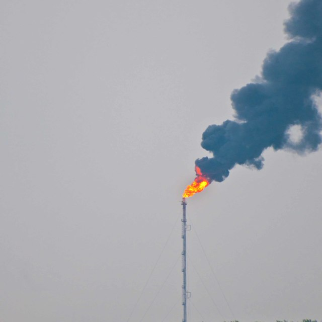 """Smoke from an oil refinery flare stack"" stock image"