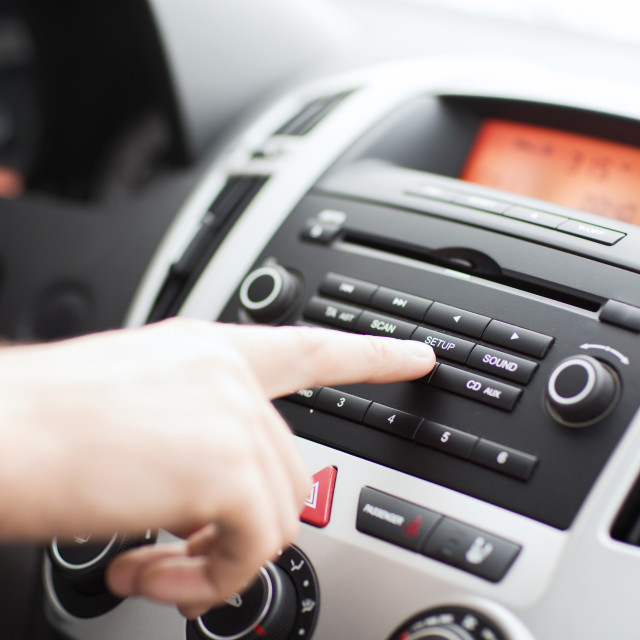 """man using car audio stereo system"" stock image"