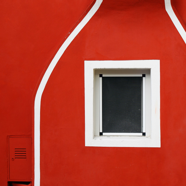 """A detail of a red facade with white lines"" stock image"