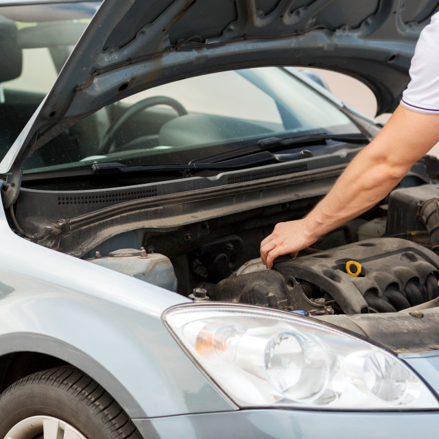 """man opening car bonnet"" stock image"