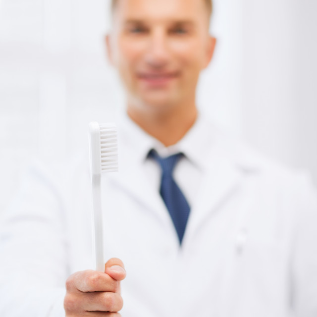 """""""dentist with toothbrush in hospital"""" stock image"""