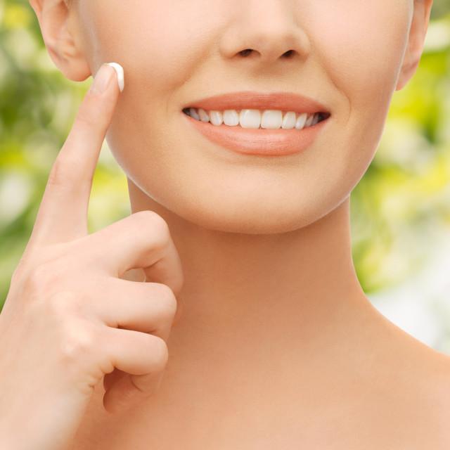 """beautiful woman applying moisturizing cream"" stock image"