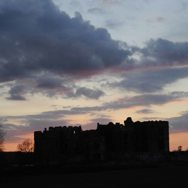 """Sun setting over Carew Castle"" stock image"