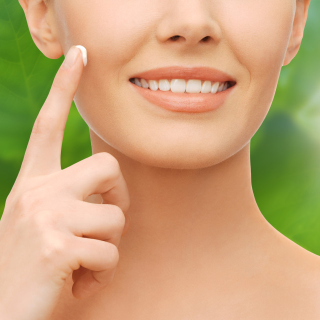 """closeup of woman hand applying moisturizing cream"" stock image"