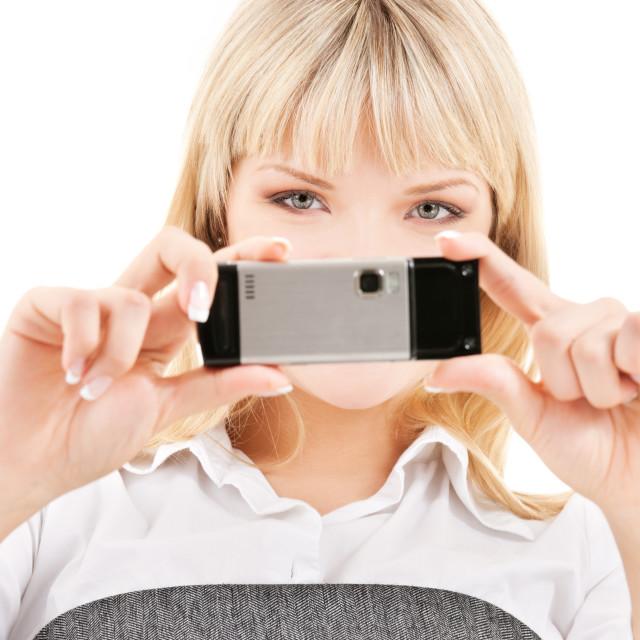 """happy woman using phone camera"" stock image"