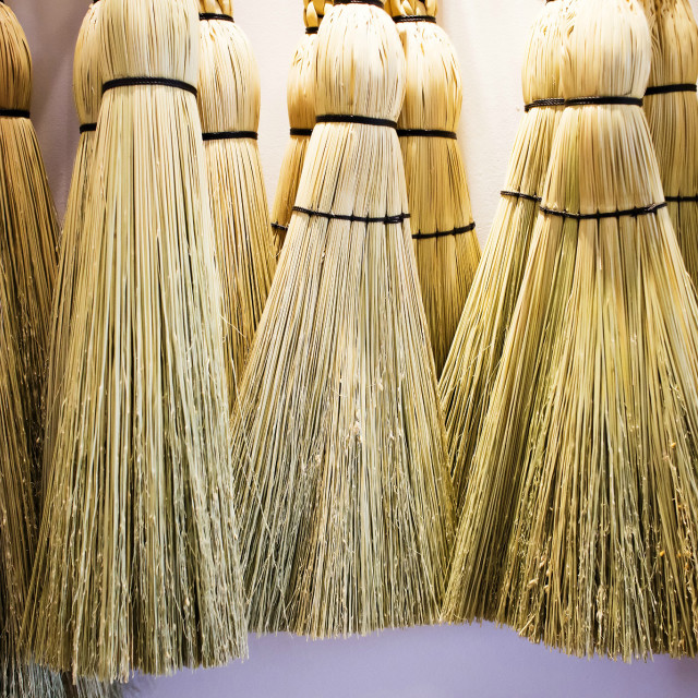 """straw brooms on the wall"" stock image"