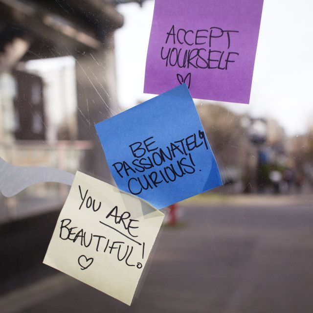 """positive sticky notes posted on bus shelter"" stock image"
