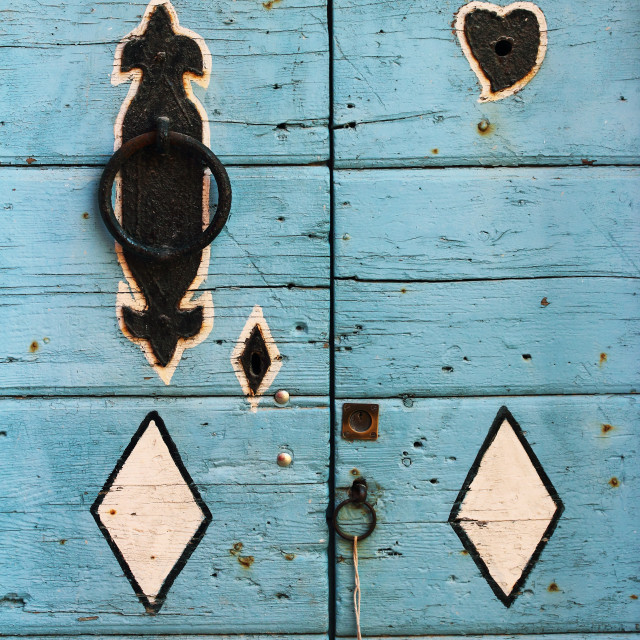"""""""Detail of an old decorated wooden door"""" stock image"""