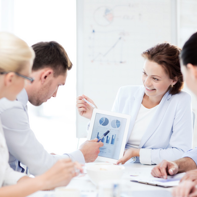 """""""business team discussing graphs in office"""" stock image"""