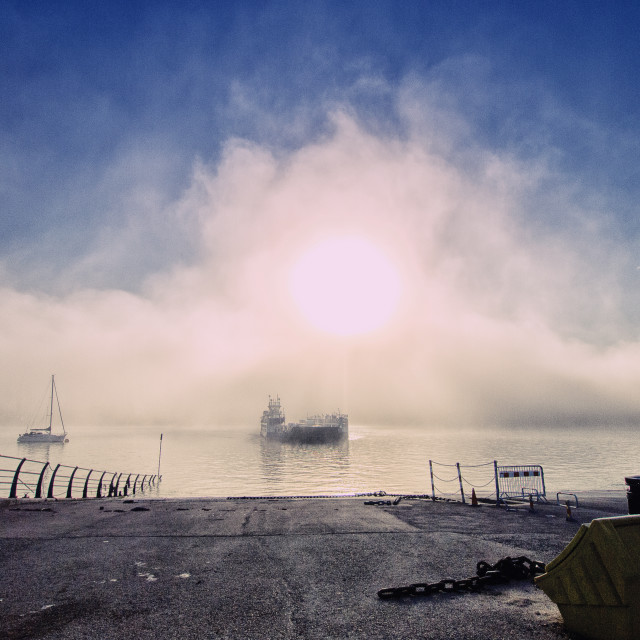 """Ferry Emerging From Mist"" stock image"