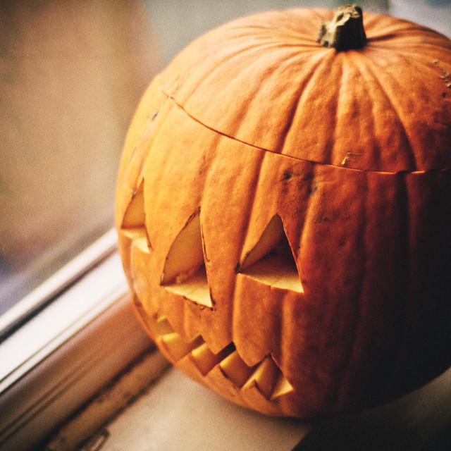 """Pumpkin by the window"" stock image"
