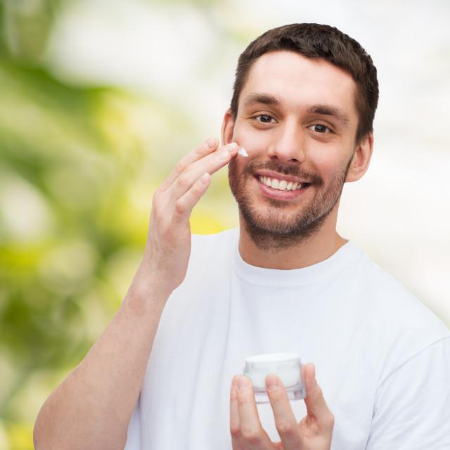 """beautiful smiling man applyin cream"" stock image"