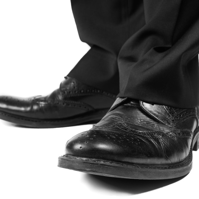 """Masculine suit wearing black shoes towards white"" stock image"