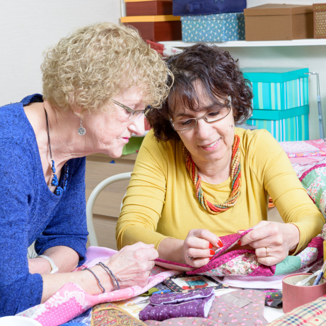 """""""two women working on their patchwork"""" stock image"""