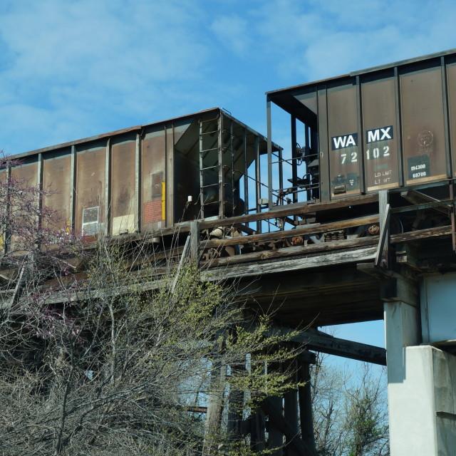 """Train cars on elevated bridge"" stock image"
