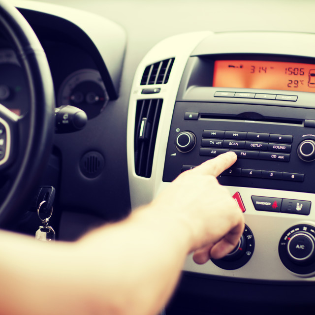 """""""man using car audio stereo system"""" stock image"""