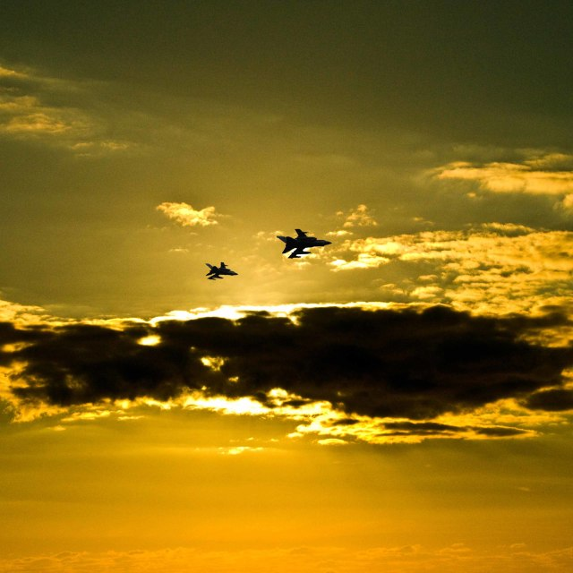 """Silhouette of a military plane."" stock image"