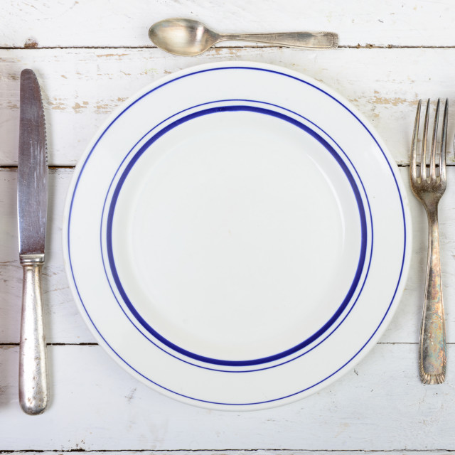 """""""plate with silver cutlery on an old table"""" stock image"""