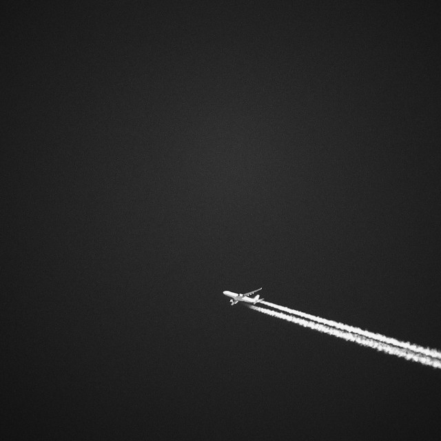 """Airplane Crossing Sky"" stock image"